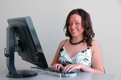 Young woman with computer Stock Images