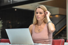 Young woman computer. An attractive young woman with a computer in a public place Stock Images