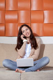 Young woman with a computer and phone Royalty Free Stock Photo