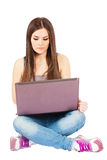Young woman with a computer Stock Images
