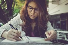 Young woman concentrate reading book. girl learning writing home royalty free stock photos