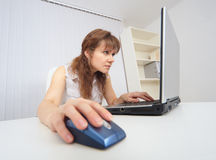 Young woman with concentration works in Internet Stock Photography