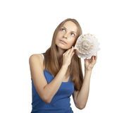 Young woman with conch, isolated on white Royalty Free Stock Images