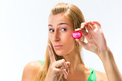 Young woman with a condom Stock Images