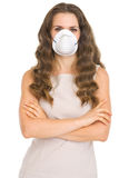 Young woman in cone mask Stock Images