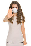 Young woman in cone mask showing stop gesture Stock Photos