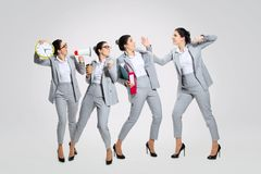 Young woman conflicts with colleagues. The worst place in the world. Young woman conflicts with colleagues `cause they`re gossip, unfriendly and arrogant royalty free stock photos