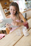 Young woman connected on wifi drinking smoothie Stock Image