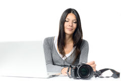 Young Woman Connecting Camera to Laptop Royalty Free Stock Images