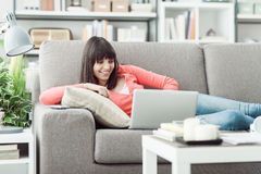 Young woman connecting with a laptop royalty free stock photos