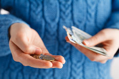 Young woman consider money. Young woman consider few  money in euro coins Royalty Free Stock Photos