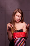 Young woman considers gifts Royalty Free Stock Photo