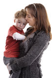 Young woman consoling a child Royalty Free Stock Photo