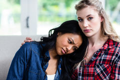 Young woman consoling upset female friend Stock Photography