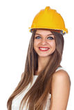 Young Woman with a Construction Helmet Royalty Free Stock Image