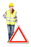 Young woman in construction helmet with road sign Stock Images