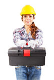Young woman in construction helmet with a toolbox. Girl worker in a construction helmet and white gloves holds toolbox, isolated Stock Photo