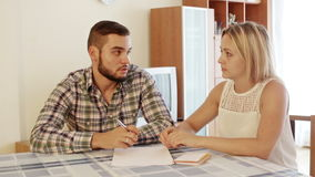 Young woman consulting with husband stock video footage