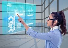 Young woman with contact glasses in a futuristic room with an interface. Stock Images