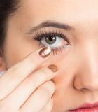 Young woman with contact lense Royalty Free Stock Images