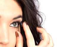 Young woman with contact lense Royalty Free Stock Photo