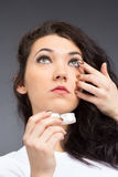 Young woman with contact lense Royalty Free Stock Photography