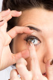 Young woman with contact lense Stock Photo