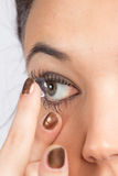 Young woman with contact lense Stock Images