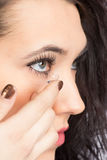 Young woman with contact lense Royalty Free Stock Image