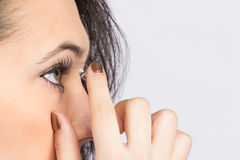 Young woman with contact lense Stock Photos