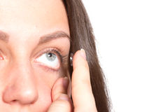 Young woman with contact lenses Royalty Free Stock Image