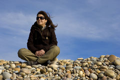 Young woman contemplating the beach Stock Photography