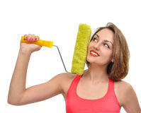 Young woman contractor worker with construction paint brush roll Royalty Free Stock Image
