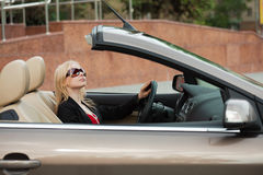 Young woman in a convertible. Stock Photo