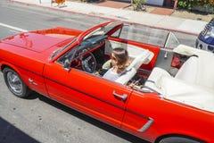 Young woman in a convertible cruising through San Diego - SAN DIEGO - CALIFORNIA - APRIL 21, 2017 Royalty Free Stock Photo