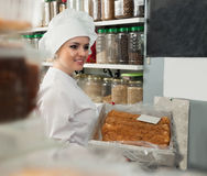 Young woman with cook hat. Posing in bakery near pastry stock photos
