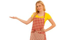Young woman cook points to copy space as she presents new recepy stock photo