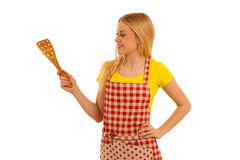 Young woman cook points to copy space as she presents new recipe.  Royalty Free Stock Photo