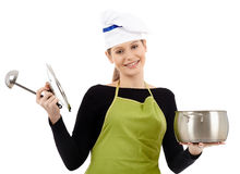 Young woman cook with pot and soup ladle Royalty Free Stock Images
