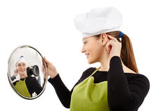 Young woman cook with a stainless pot lid Stock Image