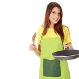 Young woman cooking Stock Images