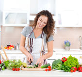 Young Woman Cooking. Healthy Food - Vegetable Salad Royalty Free Stock Image