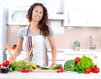 Young Woman Cooking royalty free stock images
