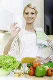 Young woman cooking. Healthy Food. Dieting Concept. Healthy Lifestyle. Cooking At Home Stock Photography