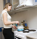 Young woman cooking. Dinner in the kitchen Royalty Free Stock Images