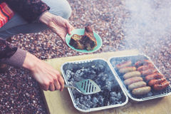 Young woman cooking on a barbecue Royalty Free Stock Photos