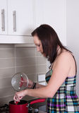 Young woman cooking dinner Stock Image