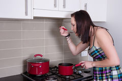 Young woman cooking dinner Stock Photography