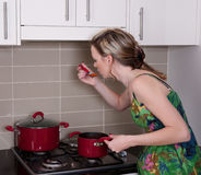 Young woman cooking dinner Royalty Free Stock Image