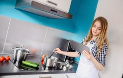 Young woman cooking  dinner Royalty Free Stock Photography